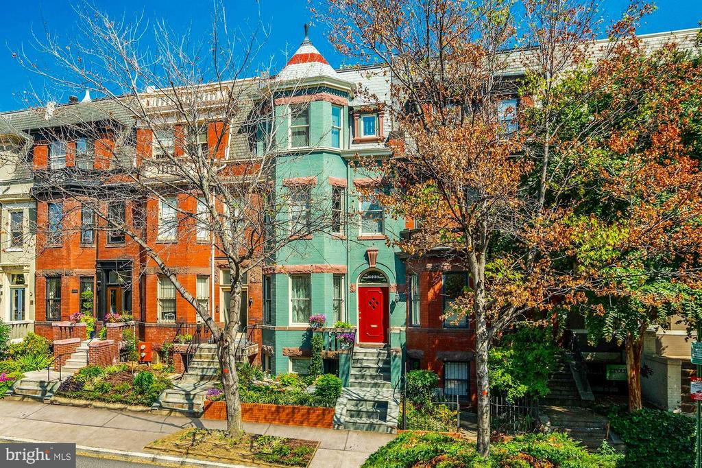 Classic Dupont Victorian Rowhouse. One owner since 1986. Circa 1902. 4000 + sq ft with a legal rental and 2 car surface parking. Completely intact with original moldings, chestnut paneling, original hardwood floors, soaring ceilings. 6-7 bedrooms, 3.5 baths, 4 levels.  Zoned R5B. Updated kitchen.