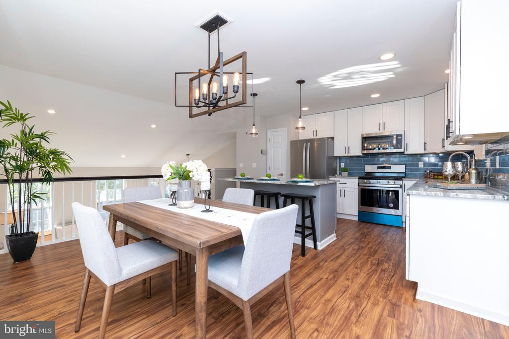 OPEN HOUSE on 11/3/19 CANCELLED.      WOW!!!  Do you want a better-than-new 4BR/3BA designer-renovated home with more than 2000 finished square feet, on a spacious lot close to the water in Middle River?  Welcome home! Imagine holiday entertaining in your open-floor-plan Living Room & Dining Room with the COMPLETELY NEW GOURMET Kitchen!  Enjoy holiday buffets on the big marble island that is perfectly situated for entertaining! Pass through the light filled, dual slider doors in the Dining area to the spacious dual decks.  Envision relaxing & having morning coffee on the decks!  Later you can grill for family & friends, all while watching the family play in the expansive, fenced backyard!  Luxuriate in your new, spacious, Master Bedroom suite with large closet.   Delight in the all-new, stylish, tile spa like bath, with custom tile and large niche!  This floor also includes a 2 more bright bedrooms as well as an updated, hall full bath for family & friends.  Even more space abounds on the first floor.   There is a large 4th bedroom, with spacious closets.  The home possesses a completely new, ceramic tile hall bath with designer finishes this level as well .   There isalso a spacious Family Room/ TV Room/Game Room/Clubroom in which friends, kids, and family can relax and play.  This home boasts an oversized, attached, two car garage.  There is even a lower level finished room great for an exercise room or man cave.   Updates to the home include new HVAC,  all new lighting throughout, new painting throughout, as well as redone landscaping. Quiet and serene cut de sac location. Your family will enjoy this wonderful home!