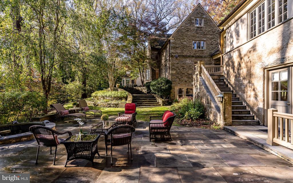 This gracious, extraordinary Walter Durham stone manor home is located at the end of a private cul-de-sac in Northside Haverford.  The home, which was originally the cherished residence of members of the Evans family, has been meticulously maintained and thoughtfully updated and modernized by the current owners. The home is a short walk to the Merion Cricket Club, the Haverford train station and all of the shopping and dining that this prestigious area of Philadelphia~s Main Line has to offer. The private grounds are an oasis with mature, manicured landscaping, and the interior of the home is washed in natural light and gorgeous views of the property, lush tree-tops and valley. The bright, freshly renovated gourmet chef's Kitchen is equipped with top of the line appliances, a large marble-topped island and ample prep and storage space.  As you flow from formal to informal living and entertaining spaces on the main level you will enjoy the wall of windows, French Doors leading to a dramatic tiered flagstone patio with alfresco dining area and a butler's pantry with glass cabinets and a beverage refrigerator. These spacious indoor/outdoor areas are perfect for cozy gatherings or full-scale holiday and special event gatherings. This level is also graced with a cheerful bay window nook that is the perfect location for a grand piano or seating overlooking the outdoor living areas.Upstairs you will find a large, luxurious Master Suite with multiple custom closets, dressing room, laundry area and spa Bathroom.  There are two additional spacious Bedrooms on this level ~ each with their own private Bathroom.  The third level has two more Bedrooms, one currently used as an office, and another full Bathroom.The finished lower level that opens to the scenic landscape and patios has plenty of storage spaces as well as an additional laundry area. The private guest suite, perfect for in-laws or an Au pair, can be accessed via stairs from the Family Room or from the lower terrace. 