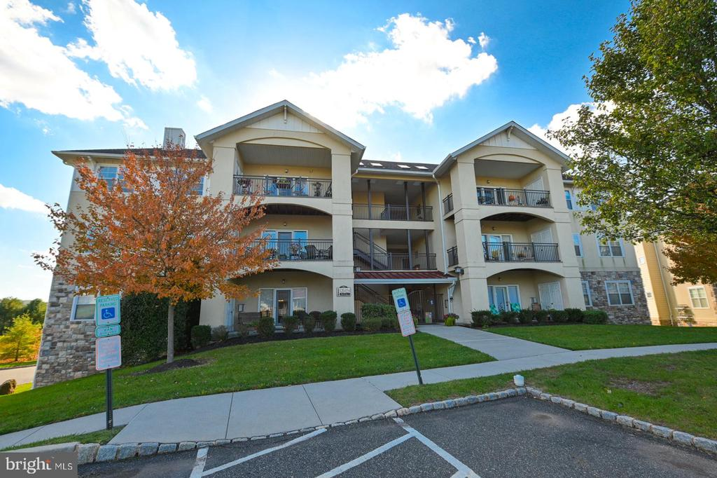 Great home at a fabulous price! The best value in Bucktown Crossing 55+ condominiums. Enjoy the rolling hills of Chester County and yet be close enough to major shopping and entertainment. These condominiums have all you need to enjoy a carefree lifestyle, secure underground parking, full access elevator, secure gated entry to each building, and on site storage.  This third floor unit has a scenic view from it's patio with a storage area which you exit to from the living area. The condo itself has extensive hardwood flooring, and nine foot ceilings. The condo itself is better than new with a central air unit in 2015, new furnace in 2019, and new hot water heater in 2017. The kitchen has a neutral grey counter top and black appliances, garbage disposal, and recessed lighting. There is a dining area adjacent to the kitchen and a separate den/office. The living area has a gas fireplace and ceiling fan for year round comfort and utility bills that average $100 per month. The bedroom is accented by a tray ceiling, walk-in closet, large bath walk-in shower. There is a beautifully furnished clubhouse with card room, full kitchen, social room with fireplace, and fitness room, as well as an outdoor recreation area with heated pool picnic pavilion and tennis courts. Don't wait to put off calling this your new home! More photos coming soon!