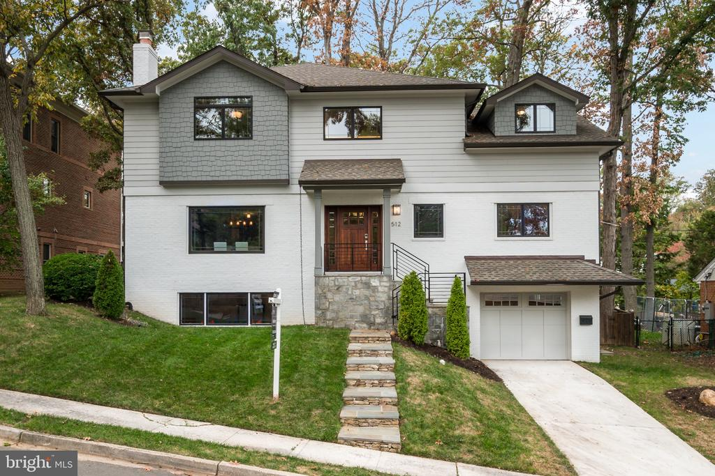 Come see this fabulous 2016 remodel/renovation by US  Capitol Homes!  Builder's three (3) year warranty is still in effect until 12.16.19!  Gorgeous open/transitional floor plan. Beautiful family room with reclaimed wood double height accent wall!  The main level has 9' ceilings, 18' family room, LED lighting and Nest thermostat.  Energy efficient home with Anderson windows.  This home boasts five bedrooms and five full baths and two half baths.  The main level bedroom, with en-suite bath, could be used as an office, main level master or in-law suite.  Gleaming dark hardwood floors compliment the main level.  Hand-set mosaic tiles grace the front entry.  Gourmet kitchen with stainless steel appliances, butler's pantry with built-in cabinetry, custom powder room, separate pantry and a custom wood breakfast bar complete the main level.  The upper level has four bedrooms and three full bathrooms.  The master bedroom has custom closets installed in 2017.  The upper level landing, with slate top, overlooks the family room.  The basement is fully finished with two rooms for your entertaining pleasure.  In addition, there is one full bath, one half bath and a mudroom off the attached garage.  The exterior of the home is brick and James Hardie plank siding.  A custom deck, built in 2017, is accessible off the kitchen.  Showcased in Remodeling Magazine and Fine Portfolio in 2016, this stunning home is not to be missed!  Minutes from DC, McLean, Falls Church, downtown Arlington and Alexandria.