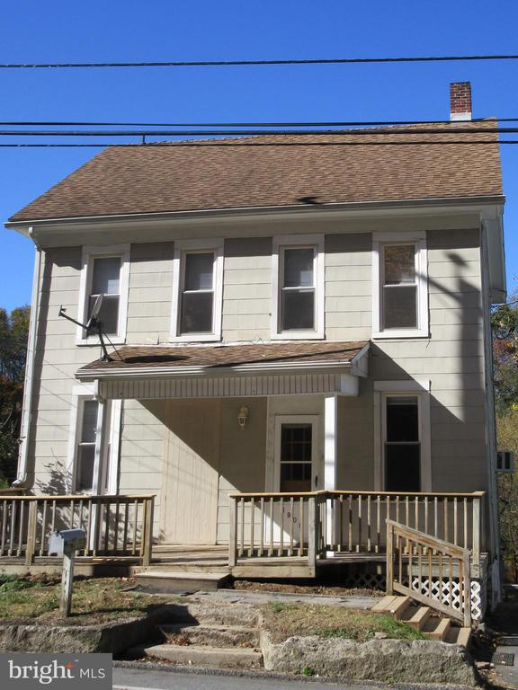 Come and see this single family home with new carpets, fresh paint, replacement windows, washer, dryer refrigerator and a one year home warranty! The property includes a covered porch, deck, off street parking, carport and a large shed, full basement and walk up attic.