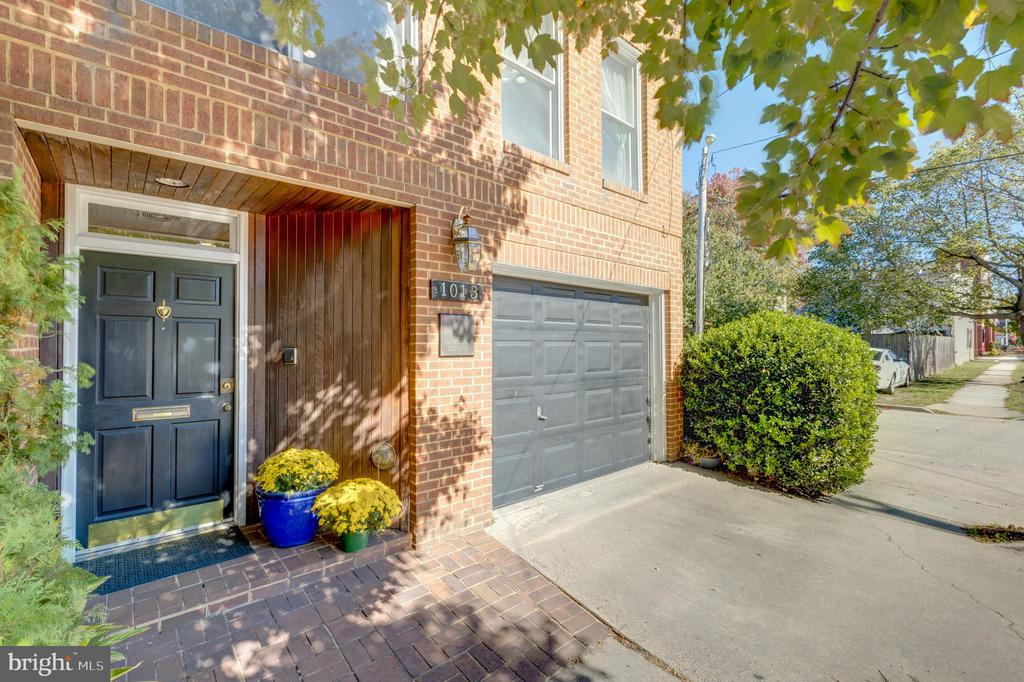 Beautiful, spacious, light-filled, rare all-brick, detached townhouse in the heart of Old Town with almost 2500 square feet of usable space. Zoned CL with potential use as office or residential. Unique~floor plan features an tile foyer with open staircase with high ceiling. First level features an open office floor plan which can easily be converted back to a garage or large, open living space with separate entrance. Second level features dramatic, large living room with two story cathedral ceilings, skylights, hardwood floors, large windows throughout and recessed lighting. There are two large, sunny rooms off the main living room, one with gorgeous built-in shelves and both offering various possibilities, including use as offices, a conference room, formal dining room or ~bedroom. Huge loft with a wall of oversize windows overlooks the main living room and could be used as a master bedroom or additional office space. Galley kitchen and 1.5 baths. Perfectly located just 500 ft. to Starbucks, a few blocks to ~restaurants, bars, hotels, specialty shops, entertainment, Metro and the riverfront. Minutes to Washington National Airport, National Harbor and MGM Casino! Easy access to Washington DC, Del Ray, Arlington & Amazon HQ2.~
