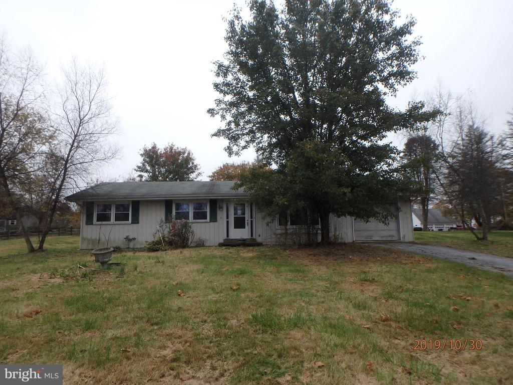 Handyman Special! Cute ranch located on large lot.  Tons of potential.  Enter into large living room. Well sized kitchen and dining room.  Three bedrooms with hall bath. Property will not qualify for all financing options.