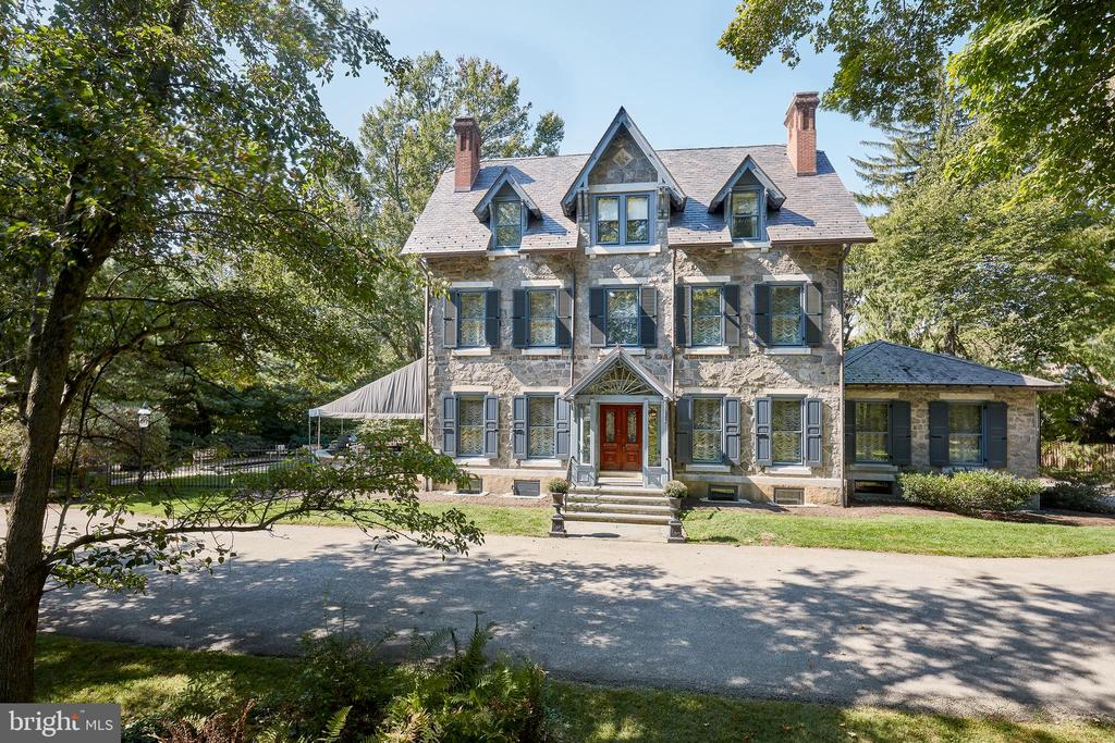 """Exquisitely renovated, sun-filled  stone Manor Home, originally built in 1880, and masterfully brought into the 21st century by renowned artisan, John Milner, with extreme attention paid to every detail and amenity. Enjoy the complete privacy while backing up to conserved Township space in a """"walk to everything including the Radnor Trail"""" location. This lovely residence offers stunning original architectural features,  perfectly restored materials, oak floors, massive moldings, millwork, beams and fireplaces of yesteryear,  perfectly blended with newly installed antique light fixtures, multiple office spaces, new Gourmet Kitchen with adjacent Family Room, exquisitely executed vintage-style Baths, new wiring, plumbing, HVAC systems and insulation, 12 foot ceilings with sun-filled floor to ceiling windows and French doors, fabulous Master Suite, and 5 other spacious bedrooms, all set on a flat 3.8 acre lot with room for a pool and tennis court. Enter through the stone pillars along the gracious circular driveway, and take in the gorgeous views of the glorious grounds, terraces, outdoor porches and more. Just minutes from the train, renowned private and Radnor schools, shopping, restaurants, 15 minutes from Center City Philadelphia, Philadelphia International Airport and 90 minutes from NYC. Turn the key and move right into this one of a kind treasure. LOW TAXES!"""