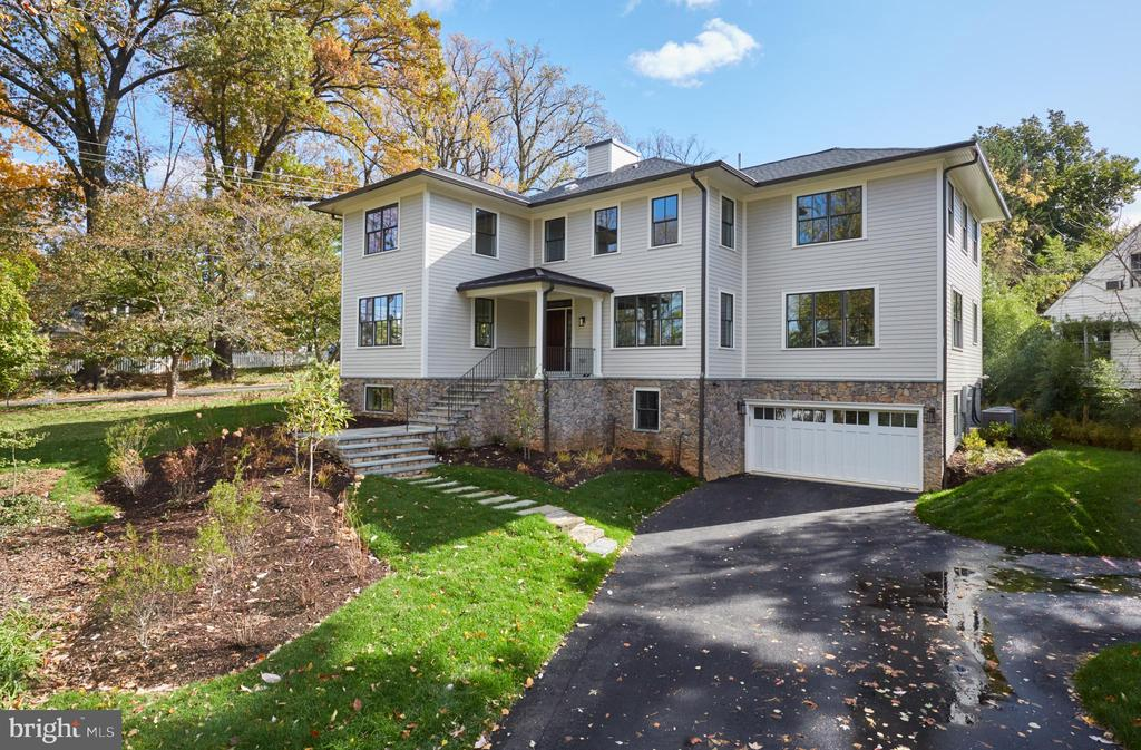 Elegant new HAST built home on a large lot located in close-in Bethesda. Fabulous floorplan with large open rooms and defined living spaces designed for entertaining and comfortable living. The main level features a massive gourmet kitchen opening to a large family room, which walks out to a covered wrap-around porch, breakfast room, formal dining room, butler pantry, and a private office. The second level boasts 4 large bedrooms (including the master suite with 3 walk-in closets), each with en suite bathrooms and ample closet space. Lower level with huge recreation room, sunny sitting room, and a 5th bedroom and bathroom / au pair suite. Sub Zero and Thermador appliances, Kohler fixtures, and optional Elevator. 2 Car Garage and ample yard space. A 4-minute bus ride to Bethesda Metro.