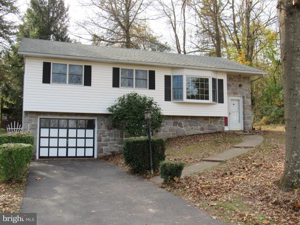 Welcome to 1266 Temple Road nestled in the Heart of Chester County in the award winning Owen J. Roberts School Dist and N. Coventry Twp. You will be delighted with this main free stone front raised rancher with stucco, stone and vinyl siding. The private driveway leads to the 1 car att garage and sidewalk to the front door. Here you find a slate tile entry with 6 steps that lead to a lg living rm/ dining rm combo. There is plenty of sunshine with the newer 8 ft bow window, 6 ft sliders and double pain windows throughout out. You will enjoy the country kitchen with plenty of cabinets, b.i. Kenmore wall oven and elec stove. On this level you will also find 3 bed rms and a full hall bath.The lower level is a full unfinished area with walk out doors to garage and the outside. Enjoy your out doors on this .53 ac country lot with a small stream, the freshly stained 20x17 rear deck  that overlooks the tree filled park like setting. Public sewer, private well, architectural singles, water treat system, oil bb heat bilco doors and walk out. Do not miss out on this well price home.   (all measurements are approx)