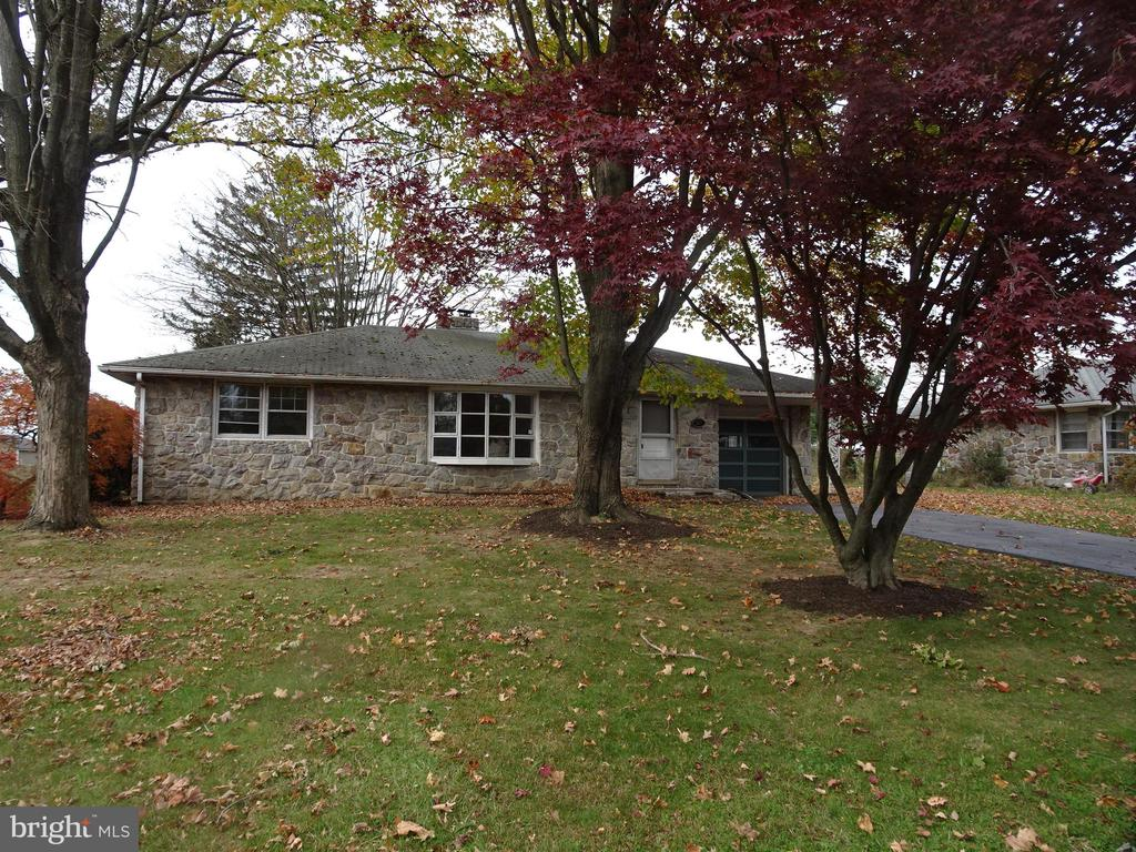 Opportunity Knocks!  Here is a nice stone ranch home in a convenient location with wonderful bucolic views.  Nestled in behind Coventry Mall, this home offers wonderful privacy, yet convenient access to shops. major roads and employment.   The one-story floorplan offers many plusses including a huge great room with a stone fireplace, a large eat-in kitchen with lots of cabinets, 3 nice sized bedrooms, an updated bathroom and interior access to the attached garage. The home is graced with hardwood floors throughout, a huge semi-finished basement with lots of extra space and a walk-up attic with even more additional space.  Outside, there are large front and rear yards, a nice paver patio in the rear and a shed all the way back ~ and of course, it all backs up to hundreds of acres of agricultural land and open space.   This is an exceptional opportunity for a buyer with the vision to see the full potential of this wonderful home.  Make sure to make your appointment to see it today!