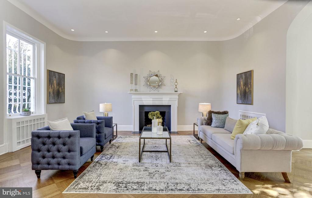 """Set atop the west village of Georgetown, the left wing of the historic """"Friendship"""" estate (circa 1800~s) where Evalyn Walsh McLean kept the famous ~Hope Diamond~.  The grand formal living room with 11~ 8~ ft high ceiling is filled with tons of natural light produced by the south-facing bay windows which overlook the luxurious heated outdoor pool.The main-level, with original patterned hardwood oak floors, centers around the warmth of the cozy fireplace which sets the perfect stage for elegant entertaining or casually enjoying quiet time with a glass of your favorite beverage.  The delicately situated powder room on the main level is a true delight with its marble and nickel finishes.The two upper levels feature 3 light-filled bedrooms and 2 full-bathrooms updated with high-end fixtures.  Built-in bookcases and cabinets enhance the master bedroom, with double closets and a large bay window overlooking the garden and pool.  Adjacent full-bathroom with mosaic tile floor, Waterworks fixtures.  Second bedroom with hardwood floors, recessed lighting, and large window with a view of National Cathedral.  Large third bedroom, and separate full-bathroom features high-end finishes ~ one of many upgrades and renovations.Exposed white-washed brick stairwell leads to the rear patio, gourmet kitchen and formal dining room on the lower-level, a common feature in historic homes of Georgetown.Expansive gourmet kitchen with under cabinet lighting and hand-made tiles, excellent counter space!  The conveniently located lower-level full-bathroom also provides access to the large heated outdoor swimming pool and patio, famously lined with Kingsville Boxwoods, a gift from the then First Lady Jackie Kennedy.  A stone staircase to the rear of the property leads to 1-car parking space.  The comfort and elegance of Georgetown, with amenities of city-living all at your doorstep."""