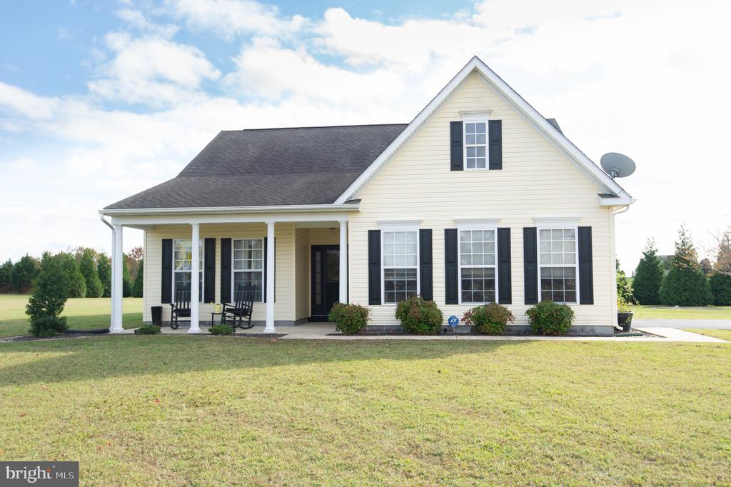 Get the look of a 2 story cape with the luxury of one story living! Many upgrades in this 3 bed 2 bath 1,600+/- sq ft. home.  Tile showers, hardwood floors throughout, stainless appliances, beautiful gas fireplace and so much more!  This home is situated on a large 2+/- acre lot that it located in the back of a cul-de-sac offering a TON of privacy.  On this large lot you  can also find some other nice upgrades including a large paver patio great for entertaining, paved driveway, attached garage, and sweet covered front porch.