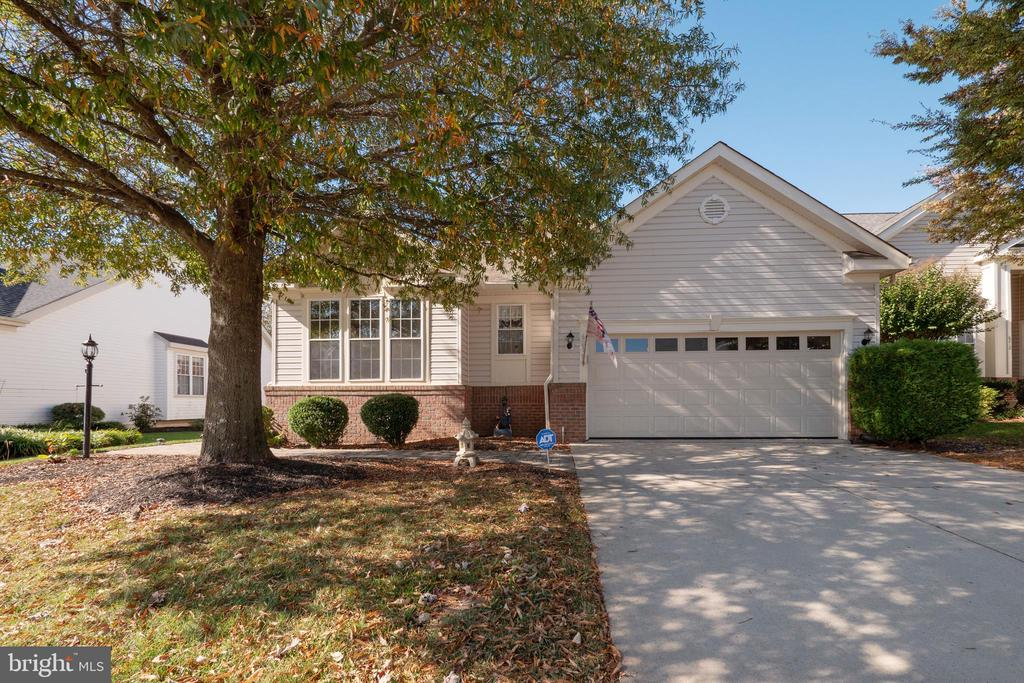 Come and visit this spacious Marjoram from the Garden Collection! This home is sunny and bright designed with a combination of open and traditional floor space. It features true one level living with Master bedroom, Guest Room, Laundry, Kitchen and Living Room~all on the Main Level. Waiting for the new chef to take over, the nicely upgraded kitchen has stainless appliances, granite counter, center prep island, and an adjacent breakfast area. A trayed ceiling, double window casement and open wall design enhances the beauty of the Formal Dining Room. The gas fireplace and gleaming hardwoods add a warm glow to the beauty of the vaulted-ceiling living room. The sunroom offers a quiet cozy place to share a cup of tea or a place to enjoy a good book. The lower level features a huge recreation room, full bath, plus, an additional finished room that could be an extra guest room, craft, office, or practice room~you choose! The home has lots of closet space and a large unfinished lower level storage space (30~x15~) . A freshly painted covered patio (35~x18~) is perfect for picnics or crab feasts! Medical, shopping, and social services are nearby! This owner is motivated to sell and waiting for an offer for a great offer!