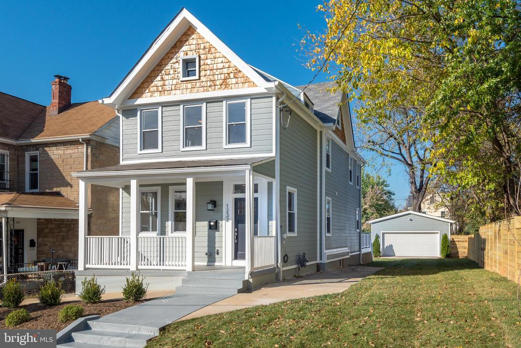 One of a kind home on huge lot in the heart of Brookland. Incredible renovation has transformed this historic home into a modern Urban Farmhouse.  Large light filled open floor plan with striking sand in place hardwood floors, custom millwork, bay window and designer fixtures.Open kitchen with spacious quartz covered Island with beverage fridge, Bertazzoni appliances, matte black hardware and beautiful tile backsplash.  Second level has beautiful owner's suite with large closet and ensuite tiled bath with double vanity. Two other bedrooms with Jack and Jill bath. Finished walk up attic space could be loft, extra bedroom, office or playroom.  Main level opens to huge deck great for relaxing and entertaining.  Step off the deck into your big private yard (just sodded) perfect for all your outdoor activities!  Very rare two car garage with electricity could be finished into additional living space, office, workshop and more!  Just steps from all the hot restaurants on 12th street- Primrose, Brooklands Finest, Menomale and more.  Blocks to yes organic market and Brookland metro.  All you could ever want in one of the most desirable locations in the city!