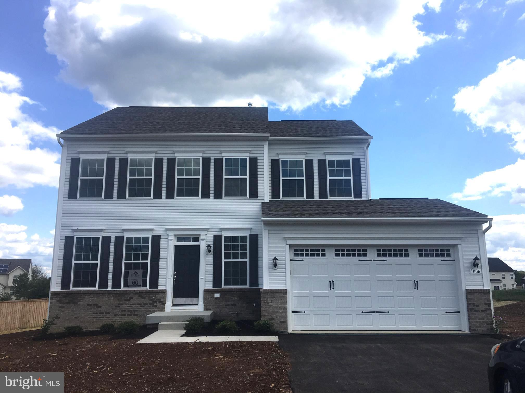 Welcome home to this gorgeous partial brick front 4B, 2 1/2 BA, 2 car garage Cypress II floorplan featuring a 4 ft. rear extension on all 3 levels,  1 1/2 story family room, stone to ceiling natural gas fireplace, spacious kitchen with upgraded maple cabinets in Willow, large island, S.S. appliances, level 2 granite, hardwood on the entire 1st floor, master suite w/cathedral ceiling, upstairs laundry & unfinished walkup bsmt. w/3pc. rough in for future expansion on 1/3 plus acres in sought after McCauley Crossing.