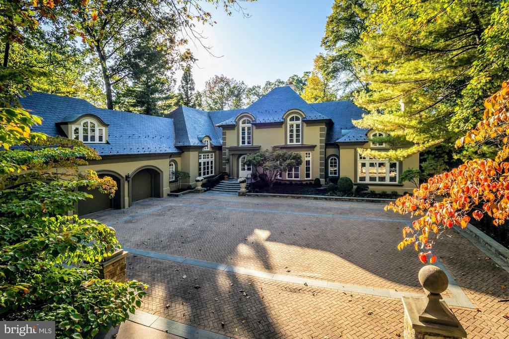 JUST LISTED! Resort-style living inside the Beltway! With its villa design, this luxurious estate on nearly one-acre will transport you. 11,800 SF of finished living space. 6 Bdrms, 5F/4H Bas, & 5 FPs. Grand scale includes soaring ceilings, dramatic curved floating staircase, an abundance of natural light, & statement lighting throughout. French doors provide seamless indoor-outdoor entertaining in the private rear w/specimens & mature plantings, pool w/cabanas/full bath, & tennis court. Main Level Owner Suite is a calming retreat, with doors to pool & back garden. Superlative attention to design & detail showcase the custom finishes & work. Stainless steel kitchen w/two islands/Subzero/Thermador. Motor court & 3-car garage. This showpiece is in a class of one.