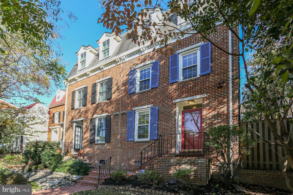 Three story brick end unit row home just a short walk to dining and shopping.   Only three blocks to King Street.  Easy access to 495, GW Parkway, and Route 1.  Walk to the metro.  Spacious room sizes and tons of natural light.  Granite and stainless steel in the kitchen with newly refinished hardwood floors continuing throughout the main level.  Separate formal dining area that can accommodate the whole family.  Main living area large enough for a variety of different furniture arrangements with built ins and gas fireplace.   Over sized windows provide views of secluded brick patio.  End unit offers additional exterior space on the side of the home with a shed and additional storage/space for other uses.  Walk out back gate to assigned parking.  The second level offers a master suite with vaulted ceilings and en suite bathroom, newer HVAC and washer and dryer, spacious second bedroom and additional full bath.  Steps up to third bedroom which can also be used as an office and/or home gym.  Recently installed ductless split  HVAC system solely for the top level rarely found in most row homes.  Additional storage space on top level and main level storage closet.  Roof replaced in 2016.