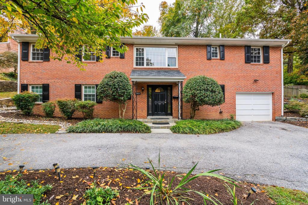 Welcome to this contemporary, renovated 3 bedroom home in a beautifully landscaped setting. The spacious foyer invites you into the formal living room with fireplace and bay window. The dining room opens to the modern kitchen with island, which opens through French doors to the patio and tiered gardens beyond. There is a finished lower level with wet bar, and garage parking.