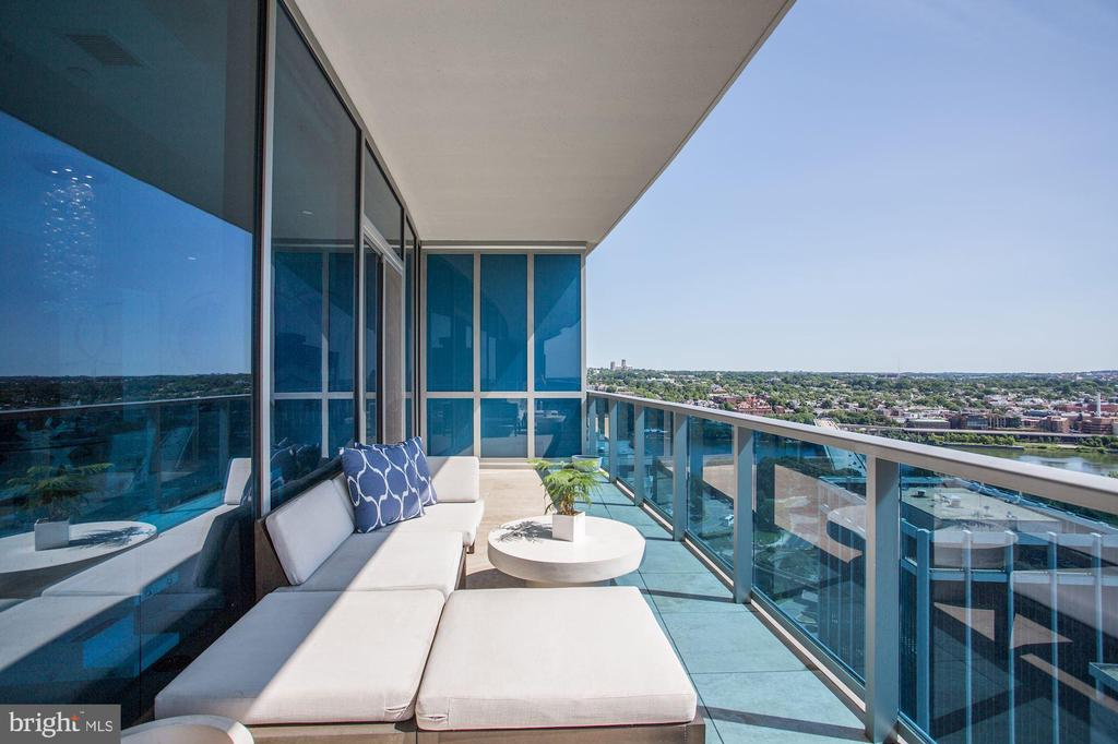 """The height of luxury"", Washington Post calls it. A pristine penthouse -2 bedroom plus 3 bedroom/den residence is uncompromised by its grace and sophisticated finishes. The den has its own bath and closet - perfect for a large 3rd bedroom. A private elevator sets the stage for this grand floorplan. Floor-to-ceiling windows frames the vibrant views of the Potomac River, Georgetown, and Rosslyn. Sweeping balcony great for entertaining. Interior space includes 2 bedrooms plus 3rd bedroom/den, 3 full baths, 1 powder room, motorized shades, custom closets, and custom flooring throughout. The best from Italy - Snaidero kitchen cabinetry, Sub-zero and Miele appliances. Residences experience the ultimate living with first-class 24 hr concierge, complimentary valet parking, fitness center, yoga studio, social room for entertaining, all-season pool, media room. Storage and 2 parking included."