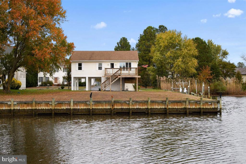 Rare opportunity to turn this 3 bedroom, 2 bath home into the waterfront home you've been dreaming of, affordably.  With 230 Feet of bulk headed WATERFRONT close to MD and DE  beaches, this gem will not last.  The large lot is the perfect setting for your outdoor oasis and mere steps to your boat and water toys.  The home has brand new carpet and paint.  With a little imagination and some elbow grease, there is a ton of potential here. Enclose the carport for an over sized garage and bedroom or game room on first floor.    Quiet street.  Low HOA fees with a wonderful community pool.  New HVAC installed 11/26/19