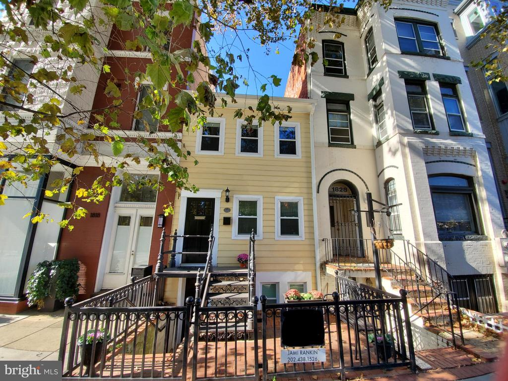 Stunning 1880 TH across from Lauriol Plaza was completely renovated in 2014.  Features include ironwork fence, gate & entry stairs, exposed brick walls, wood floors, stainless & granite kitchen, 4 updated full baths, lower level in-law suite & rear fenced patio & 2-car parking.  Master Suite features huge walk-in closet & spacious, sky-lit en-suite bath with corner tub.  2nd large BR up with full bath in hall.  Lower level has front & rear entrances, custom built-ins, life-proof tile flooring, kitchenette & full bath.  Recently used as Air BNB generates $100k annual income.  Walkscore of 98! .3 miles to Dupont Metro. Zoned MU-17 which permits moderate density mixed use development.  It's one of a kind!