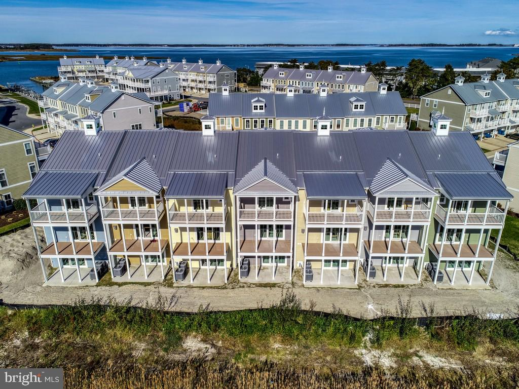 Sandy Cove on the Indian River Bay - Long Awaited building 400 Overlooking White Creek and wetlands!  Waterfront community with marina, boat ramp, pool, private beach, fishing & crabbing pier, & easy access to the Indian River Bay & Atlantic Ocean! Building 400 is located on the wetlands adjoining White Creek and offers unobstructed water views! Affordable coastal living with tile shower and tub in master bathroom, granite counters and stainless appliances in kitchen, elevator shaft, three levels of decks, & gas fireplace standard. Incentive value is $20K and can be used for two jet skis and trailer, boat, deeded slip, rate buy down, or towards purchase price, upgrades, or closing costs - you decide. Come and discover the best value on new construction townhomes with waterviews and water access! Energy efficient home built by Select Builders with a HERS score of 60 to 66! UNIT 401 - located on White Creek! Detailed Brochure attached. Ready for your selections - delivery spring/summer 2020.