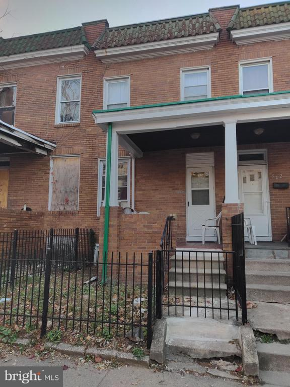 Come see this 3 bedroom 1 bath porch front town home has been updated with wood floors throughout, currently tenant occupied and tenant wants to stay . Very well maintained solid home with radiating heat , window units, double paned windows and Full basement for storage convert to another bedroom .