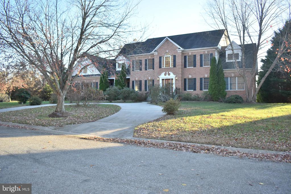 Huge ALL BRICK Colonial in Old South Country Club.  Dramatic circular driveway and attached 3 car garage.  A large deck off the kitchen and family room overlooks the  rolling rear yard and provides views of the golf course.  Beautiful hardwood flooring throughout the home and an open floor plan with gourmet kitchen including abundant cabinets, granite  counter tops and upgraded appliances.  Massive master bedroom suite with tons of closet space, sitting room and private balcony.  Fully finished basement with fireplace and walk out to spacious patio.  Too many features to list!!!