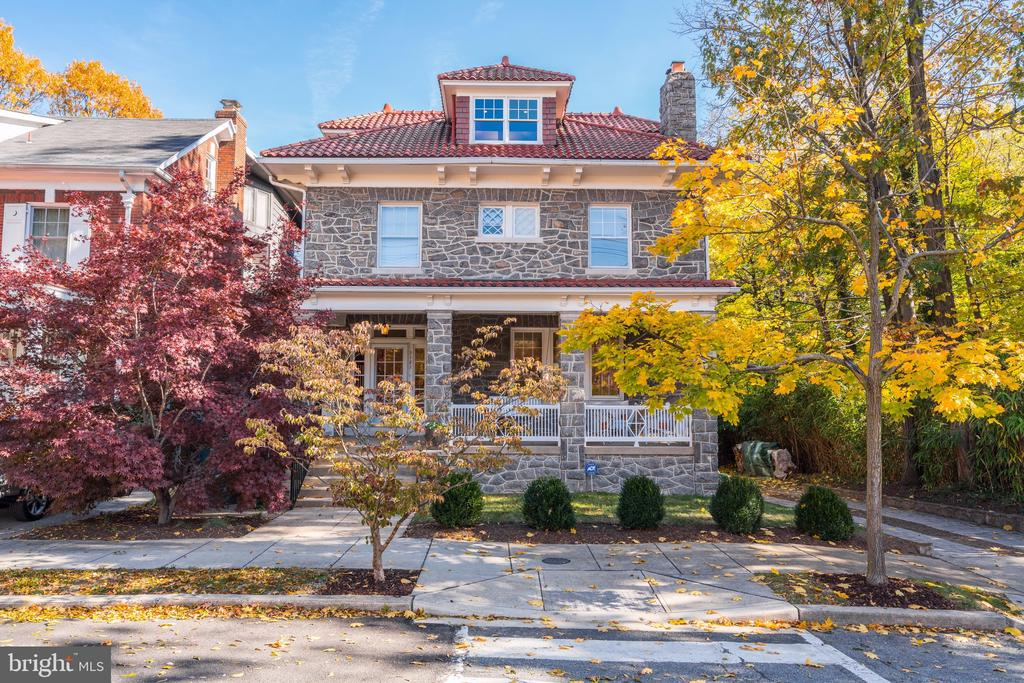 JUST LISTED! OPEN SUN 11/17 2-4PM! CLEVELAND PARK URBAN OASIS - DON'T MISS THIS INCREDIBLE OPPORTUNITY! This exquisite stone American Foursquare in the heart of historic and convenient Cleveland Park is set on a spacious and level 7,500 SF lot with an ethereal, deep backyard surrounded by the grounds of the Twin Oaks estate with unrivaled privacy and serene, leafy views. The pristinely maintained home features a large front porch and bright and airy interior with high ceilings, enchanting period details, and many large windows with unencumbered vistas of its tranquil, sylvan setting. Main level has 9.5' ceilings and features gracious entryway, formal living and dining rooms, full bath, large family room and kitchen, upstairs are 4-5 bedrooms, 2 baths, and a large sunroom with deck. Spacious and sunny lower level, driveway and garage parking. Easily walkable to Metro/transit and steps to multiple schools, 2Amys, Cactus Cantina, Barcelona, Silver, Giant, CVS, Solidcore, Bluemercury, soon-to-be Matchbox at Cathedral Commons and Hearst Pool!