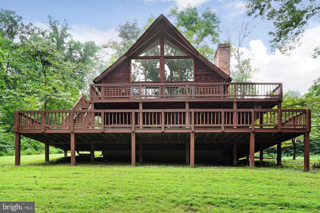 Every time you drive down the driveway of this beautiful home, you will feel as if you just arrived at your vacation rental.  However, this home is only 4 miles from downtown Shepherdstown which includes various restaurants & shopping.  Imagine watching the snow fall from the A-framed window while enjoying a cozy fire in your family room.  In the spring, the views are just as incredible.  You will enjoy watching the trees bloom, the songbirds, deer & other wildlife.  The spacious master bedroom &  bath is on the main floor and includes an oversized, soaking jacuzzi tub.  There are two spacious bedrooms and a full bath on the upper level as well as a loft that over looks the family room and provides the same spectacular views.  The lower level Great Room includes a dry bar area & a full bathroom with shower.  it could be perfect as an in-law suite with it's own deck and entrance.  This 2.39 acre lot is private & partially wooded.  Residing in Steamboat Run Estates includes access to the Potomac River and the owners have included kayaks for your enjoyment as well as a BBQ Grill & lawn equipment.  There is a lot of storage space and a large, two story deck to enjoy year round.  Pets are ok on a case by case basis.  Monthly rent amount & security deposit is $2500.