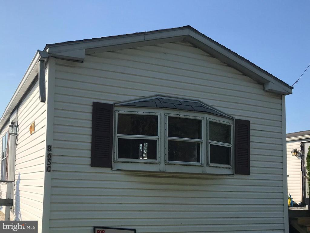 Tired of paying your landlord's mortgage? Have you been searching for a way to purchase your very OWN home and REDUCE your expenses ALL AT THE SAME TIME? If you are handy and not afraid of taking on a project, this 2-bedroom, 1-bath home is the PERFECT answer. The home needs repair and will definitely require some sweat equity however; once updated, you will have YOUR perfect home! Where else are you going to find a custom home, designed by YOU, perfectly matching your specific taste, budget and needs all for under $600 per month? Current apartment rents are 2 to 3 times that amount. One other luxury you will be able to enjoy (not to mention ~ save some more $) is your very OWN laundry facilities. Yep, that is right ~ no more trips to the laundry mat! Terrific location with easy access to all major routes and public transportation. If this particular home does not match your needs, there are currently 2 homes available (864 Aspen Avenue and 845 Cypress Avenue). One is sure to meet your needs. Property is being sold as-is. Lot Rent/HOA fee is $539 per month. Lot rent covers: cold water, sewer, trash, recycling, parking, common area snow removal and common area maintenance. Association approval is required.