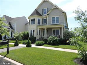This beautiful estate home located in Parkside, one of the most prestigious neighborhoods in Middletown. Parkside is an amenity-filled community close to the conveniences of Downtown Middletown and is in the Appoquinimink School District.  Seated on a premium corner lot, this luxury home offers plenty.  The front porch leads into the impressive two story foyer featuring an open curved staircase - perfect for photos!  On either side of stately columns, you will find the formal living room and the formal dining room.  Hardwood floors stretch down a corridor to the private study with a wall of built-ins.  At the heart of the home, you'll find the well-appointed kitchen - 42 inch cabinetry, black granite counter tops, custom marble back splash, stainless appliances including a Thermador gas range.  Standing at the center island, you are looking out into the great room, complete with a 3 sided gas fireplace.  The open layout makes for effortless entertaining.  Step out the rear door to the custom paver patio.  The lawn features an underground irrigation system.  The basement has both egress window and a bathroom rough in for future finishing.  The second story leads to the Owner's suite .  This vast room will certainly make the grade with the tray ceiling, cavernous walk in closet and separate sitting area.  A second 3 sided gas fireplace will add a romantic glow to the room.  Inside the en suite bathroom, a whirlpool tub sits alongside a tiled, over sized shower with glass door.   A double bowl vanity and ceramic tile floor complement this space.  3 additional spacious bedrooms and a full bath, again with custom tile work round out the second level.  Parkside offers it's residents an inground pool, tennis courts, clubhouse with fitness center and a playground.  This luxurious property is only missing one thing...you!