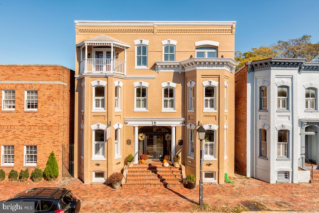 """Distinctive, elegant and in the heart of Old Town, Alexandria. Originally built in the 1900's, two row homes were combined and extensively renovated in 1985. The building's striking exterior makes a statement and pays homage to the historic charm Old Town Alexandria is famous for.  The interior is simply stunning.  Exposed brick, exquisite mouldings, custom millwork, built in's, marble and more. This impressive building features 10ft plus ceiling heights, private parking, loads of natural light and gorgeous hardwoods. A gourmet chef's kitchen, opens to multiple living and dining spaces where entertaining, work or divine daily living can happen. A balcony on the front side and a wrap around deck on the back side lend a little """"Southern charm"""" to this rare piece of Alexandria architecture. With more than 2,400 square feet of refined living space, you may be tempted to stay indoors. However, this beauty is in the heart of quintessential Old Town. Fine dining, bars, shopping, historical landmarks, waterfront activities, and more. King Street metro is within walking distance or you could be in DC by car within 15 min. This sophisticated and stylish space leaves nothing to be desired. Shown by appointment only."""