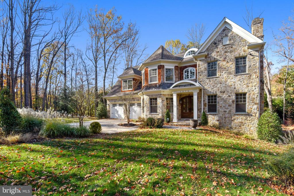 This Spectacular Custom home with nearly 8000 Sq Ft finished Space, sits on a .61 Acre Level lot at the end of a dead-end street within 10 minutes of hustle and bustle of Tyson's Corner. Exterior of this home is studded with Cedar Shake Shingles and Stone and finished with Large Deck and a Stone Patio backing to complete privacy with trees, shrubs and a small stream flowing at the back end of this magnificent lot. Flooded with Natural Light with lots of Windows, French Doors, Arched Openings, 10'Ceilings embellished with custom Crown Moldings, recessed Lighting , Masonry 4 Gas Fire Places give an immediate impression of what to expect in this lovely home. State -of -the -Art, Chef's Kitchen with Granite and Marble Counter Tops, Wolf appliances --Stove with 6 Burners, Under Cabinet Microwave, A full size Wine Cooler, huge Center Island and a lighted beautiful Breakfast Nook count for some of the extravaganza to be explored in rest of the house. 5 Bed Rooms, 5 Full bathrooms, 3 Powder Rooms, 1 bonus room intended to be an Exercise Room, a Media Room, A Butler's Pantry with a vessel sink, Gracious Wood floors, Executive's office/ Library, a top-of-the -line Elevator, a Media Room, a Game Room, expansive recreation Room make up some of the features of this beautiful home.Master Bed Room with Tray Ceilings, a Gas Fire Place, a Breakfast/ Bar, a State-of-the Art Spa Bath , two huge walk-in Closets sets this home apart for a comfortable life-style.Private Well and Septic with heat source Propane Gas, Electric Central A/C (3 Zone) Programmable Thermostats, an Alarm System, a Sprinkler System for the Lawn.There is NO Home Owner's Association!!