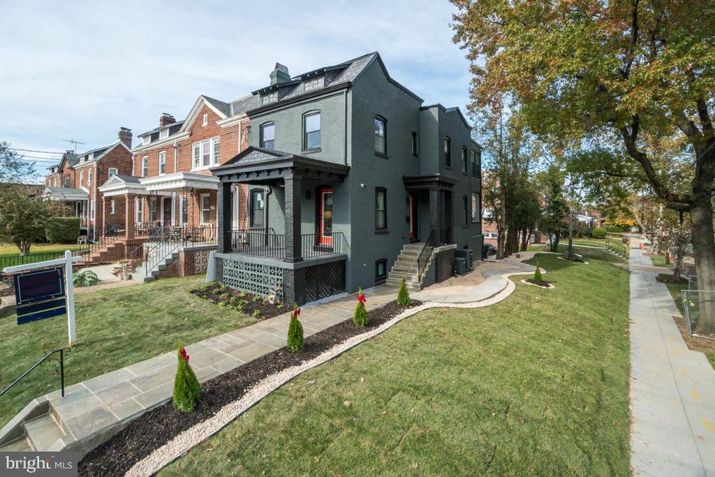Fall into your new home for the holidays! This stunning renovation designed with superior style in one of D.C.'s most desirable neighborhoods, Brookland, is awaiting you. 1348 Shepherd ST NE is a semi-detached row home with an expansive master bedroom with ensuite bathroom, three additional bedrooms, three additional bathrooms, and a half bath on the main level. The well appointed main living level includes a spacious living room with fireplace, dining room suited for the holidays leading into a gourmet kitchen boasting Bosch stainless steel appliances, a large waterfall island, and finishing with a bonus sun room perfect for entertaining! Downstairs features a fully finished basement featuring a fourth bedroom with it's own separate entrance and gorgeous full bath! Greeted by a large private drive way in rear guarantees designated parking for a warm welcome home. Photos coming soon & join me for a twilight debut November 14, 2019 from 5pm-7pm!