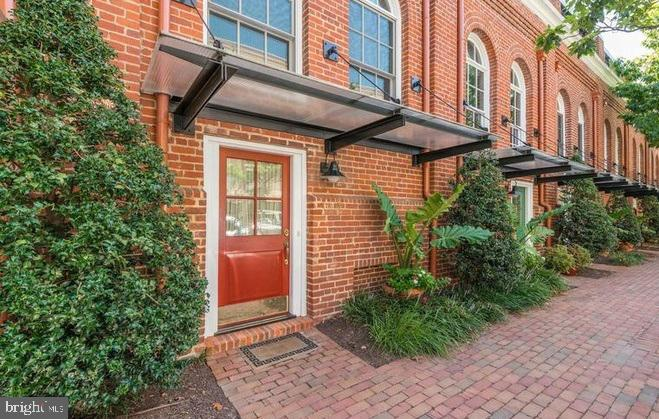 Elegant Townhouse in historic Portner Brewery complex featuring 12' ceilings and wood floors on main level. Open kitchen and living room concept with access to a private brick patio. Carpet was installed in 2017 on second and third level. Large balcony off the master bedroom with a walk-in closet. Private parking in garage completes this unit. Near Metro, Old Town and more!