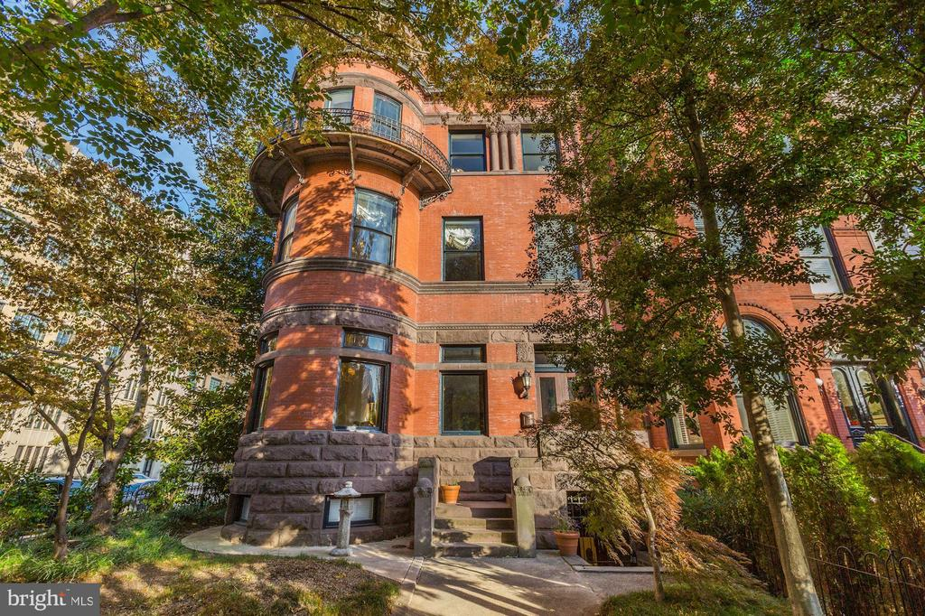 OPEN HOUSE! SUNDAY, JAN 12th 1-4P! Downton Abbey West! This is a once in a generation opportunity to own a historic Dupont Mansion prominently sited on the corner of 16th and R Street and designed by Bruce Gray in the 1880s in the Richardsonian Romanesque tradition. It is a massive property with 10-12 BR/6 1/2 BA, soaring ceilings with over 9000 sf combining a heavy stone rusticated exterior with delicate beauty as seen in the foliate decoration of the columns.  The medieval conical tower and rounded windows have French-inspired wrought-iron balconies. The asymmetrical composition, rusticated surfaces, sandstone walls, belt course, and entablature are all common to Queen Anne houses of this period.  However, they are seen here in a particularly felicitous combination that makes the house absolutely unique, even in Washington.  In addition to the main house, there is a carriage house, an au-pair suite, garage parking space, and one surface parking space. The former Embassy of Bolivia, and later Ecuador, it is one of the largest townhouses over 9,000+ square feet in the Dupont/Logan area. Many cultural resources and neighborhood parks are nearby. The Dupont Metro and the U Street Metros are short walks.