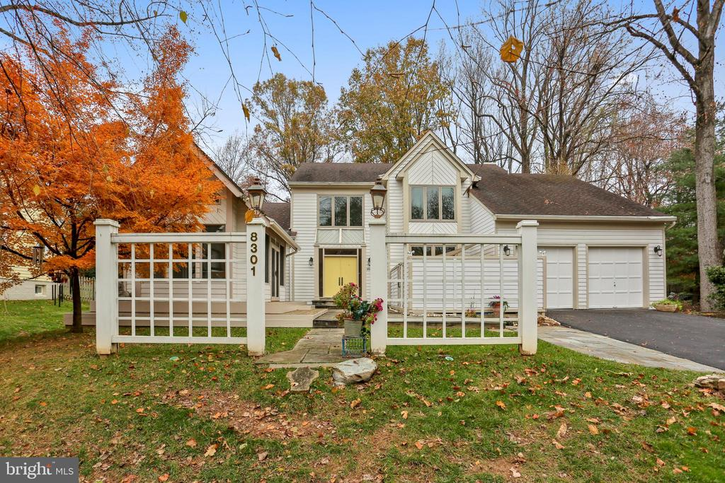 AMAZING PRICE REDUCTION! SELLERS LOSS - YOUR GAIN!! Light, Bright, and Spacious - AMAZING PROPERTY - with soaring ceilings, sky-lites, hardwood floors, Anderson windows, and the most wonderful and unique additions: a 3 season screened porch and an exterior spa room.Main level has updated kitchen with granite counters, stainless appliances and desk, study, large family room  with built-in book cases flanking the fireplace- spacious  dining room and large living room that has another fireplace as well as access to the screened porch, easily updated into an all season's room. The fully carpeted upper level has a very special master suite with cathedral ceiling and lush master bath. Custom recessed lighting is throughout. There are 3 additional bedrooms (all good size) and 2 more full baths. The lower level is enormous and ready for your design. The location is fantastic:   the Pyle-Whitman cluster and Carderock Springs Elementary School. Convenient to major commuting routes as well as the C & O Canal for recreation, the charm of Cabin John, and Washington, DC for everything the city has to offer.You will love living here!