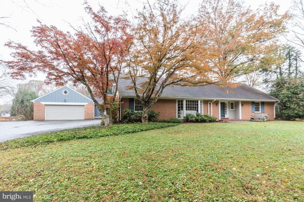 Persimmon Tree Ln is one of Bethesda's best kept secrets with charming homes on large lots. 7700 Persimmon Tree Ln is no exception with approximately 4450 finished SQ FT.  on the main level and upper level on an outstanding 2 Acre lot. Highlights of the main floor include a large living room with a fireplace, an adjacent dining room and a family room with fireplace and sliding glass door to the patio.  The kitchen has newer appliances and opens to a sun room/breakfast room also overlooking the back yard.  Completing the first floor are three bedrooms and two full baths including an alternate main level master bedroom with a full ensuite bathroom. The upper level has a Master Suite with a bedroom, sitting room, walk-in area and coffee bar, a large all purpose room and work space with built-ins. A Generac generator provides standby power (heat, electric, water and well).  The large lower level offers future potential to finish. The location provides easy access to I-495 and I-270 as well as Virginia and Downtown Washington. Both public and private schools are some of the areas best.