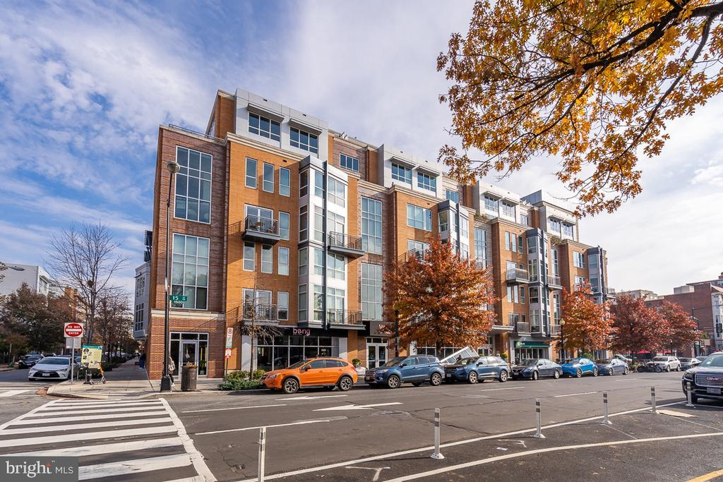 Urban living defined in the Metropole with its sleek, modern design located in Logan Circle. This 2 Bed/2.5 Bath condo with parking and storage space offers a warm and inviting high design to complement the ultra-modern, cool lines of the exterior. A loft-style open plan living space with floor to ceiling windows, wide plank hardwood floors, and private balcony is the ideal venue to show off to friends. Cook in your gourmet style eat-in kitchen with stainless steel appliances and large center island. After entertaining, retreat to your master suite with walk-in closet and rejuvenate in the contemporary hotel-inspired bathroom. Another well-apportioned  bedroom with en-suite bathroom and walk-in closet completes the upper floor. The Metropole offers concierge service, a spa and fitness center. Located directly across the street from Whole Foods and a large variety of restaurants and shops. Less than a mile to the nearest Metro station.
