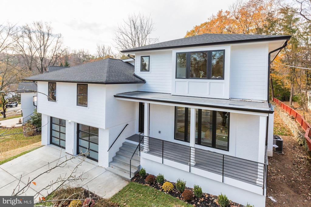 Stunning 5 bedroom, 3.5 bath completely renovated top to bottom. Home sits on a 1/4 acre lot , just minutes from downtown Bethesda! Beautiful hardwood floors throughout. 2 Master bedrooms Suites. Spacious kitchen consisting of long center island with marble top, generous cabinet storage, sleek counters and a roomy breakfast Bar. Laundry closet on bedroom's level. The Owner~s suite with high ceilings occupies the top level and includes a split walk-in closet for both and a full bath including a soaking tub and dual vanities. The lower level has a half bath, a walk-out to level back yard. An attached 2-car garage and driveway that can accommodate 4 cars provide ample parking.