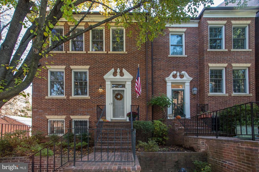 NEW LISTING!! OPEN SUNDAY DEC. 15th FROM 2-4PM! Welcome to this beautifully updated end unit townhome in the sought after Cloisters in Georgetown. The main level welcomes you with an entry foyer and charming renovated kitchen with double windows and renovated powder room. Beyond the entry hall you will find the inviting spacious dining room and full size living room with wood burning fireplace. The upper level offers 3 bedrooms and 2 beautifully renovated full baths. The daylight walkout lower level provides a full 4th bedroom and bath, family room with fireplace, and is level with the patio and garage. Full size 1 car garage plus 1 car parking pad add to the amenities of this inviting Georgetown home.