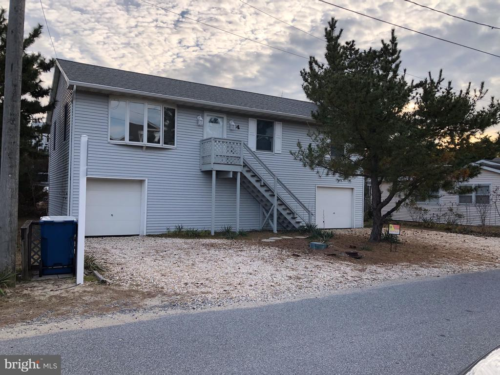 Location, location, location!   Only steps away from the Atlantic Ocean in the ocean block in South Bethany Beach.   Enjoy this furnished three bedroom, two bath coastal cottage.  This home is located on a 70ft x 70ft lot that is three from the beach on the oceanside.   Enjoy this traditional beach cottage or build your paradise home with the potential to capture ocean views.  Located on a large lot with an outside shower and rear deck off of the main level elevated on pilings.  Only a short walk to dining and shopping, this home is located on a quiet street in South Bethany which is known for its beautiful wide life guarded beach.