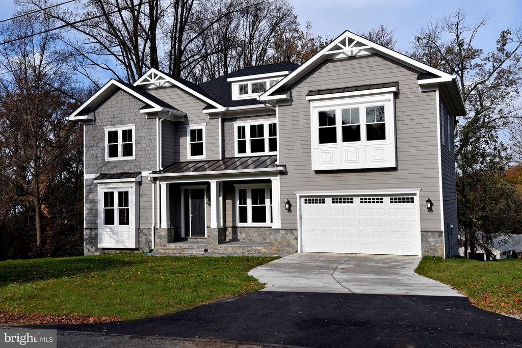 Brand new construction in a quiet and peaceful cul-de-sac in Falls Church (McLean High School). 5,770 SF of finished living space with an ELEVATOR and a beautiful backyard with scenic views. Conveniently located 1.3 Miles to West Falls Church Metro, 1.5 miles to Tysons Corner Mall. Seconds to I-66 and the beltway. McLean High School, Longfellow Middle School, Lemon Road Elementary School.  Stone and James Hardie-Shingles Front Facade . James Hardi- Lap Siding with ColorPlus Technology. 30 Year Architectural Roof Shingles. Beautiful flagstone patio. 5 spacious bedrooms, 5 full bathrooms, 1 half bath. All upper level bedrooms with own in suite bathroom. Main level office. 10' ceilings on main and lower level. 9' on upper level, 10' in bedrooms. Craftsman trim package with two-piece and three-piece crown molding throughout. 2 step tray ceiling and coffered ceiling. Red oak hardwood flooring throughout, solid core doors. Laminate flooring in basement. High end quartz. High end Thermador stainless steel built-in appliances. Butler's pantry with wine cooler. Mud room with built ins and separate coat closet. Master bedroom suite boasts a large sitting area, a wet bar, his and her closets, and an incredible master bathroom with a free standing tub, marble tile and counter tops,  and marble shower, as well as his and her sinks. High end maple vanities in all bathrooms. High end Kohler toilets, Moen faucets. Recessed lighting throughout. R-15 insulation in all exterior walls, R-38 blown-in insulation in attic. 45' gas fireplace surrounded with high end custom Quartz in the family room. 2nd level laundry room. You don't want to miss out on this gem.