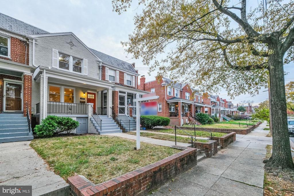 OPEN SUNDAY 11/24 from 1-4pm - Fashionably Traditional & nestled in tranquility.  The charm & character of this brick porch front Colonial has been preserved, while modern adjustments were made to maximize the use for practical function & flow.  Formal living room, that overlooks the porch & extended front yard, has original built-in side  shelves & archway leading into the contemporary Country tablespace Kitchen with center island. There is a rear exit to the newly laid patio  & expansive yard +OFF STREET PARKING, as well as access to the lower level. The upper level has 3 spacious Bedrooms and 1st Full Bath.  The lower level has a wide open family or theater room. There is a 4th Bedroom/den with quick access to the 2nd Full Bath, laundry facilities and the rear exit.