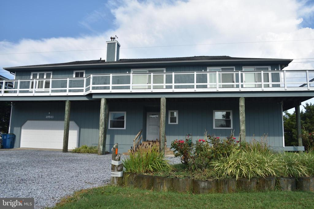 Spectacular 5 bedroom, 3 bath home facing Cove. Recent updates including all new LVP flooring and fresh paint throughout. Fantastic wrap around low maintenance deck with amazing views.Open layout with updated kitchen with newer Stainless appliances and granite countertops. New windows recently installed throughout. High Efficiency duel system, cooling/heating. Community has access rights to both Ocean beach area and boating ramp and docks on bay side. Built-in Dumbwaiter to help bring your groceries in from the lower level up to the kitchen. Oversized two car garage with its own HVAC unit. Outdoor shower for rinsing off when getting back from the nearby beach which is within walking distance. Lush, open flat back yard great for outdoor activities. Tennis courts and boat ramps/docks are within a few hundred feet from front door. Lots of driveway parking to accommodate your guests. Great Rental potential. Don't miss scheduling this one, it is very clean, ready for quick occupation and priced to sell! Make it yours today!
