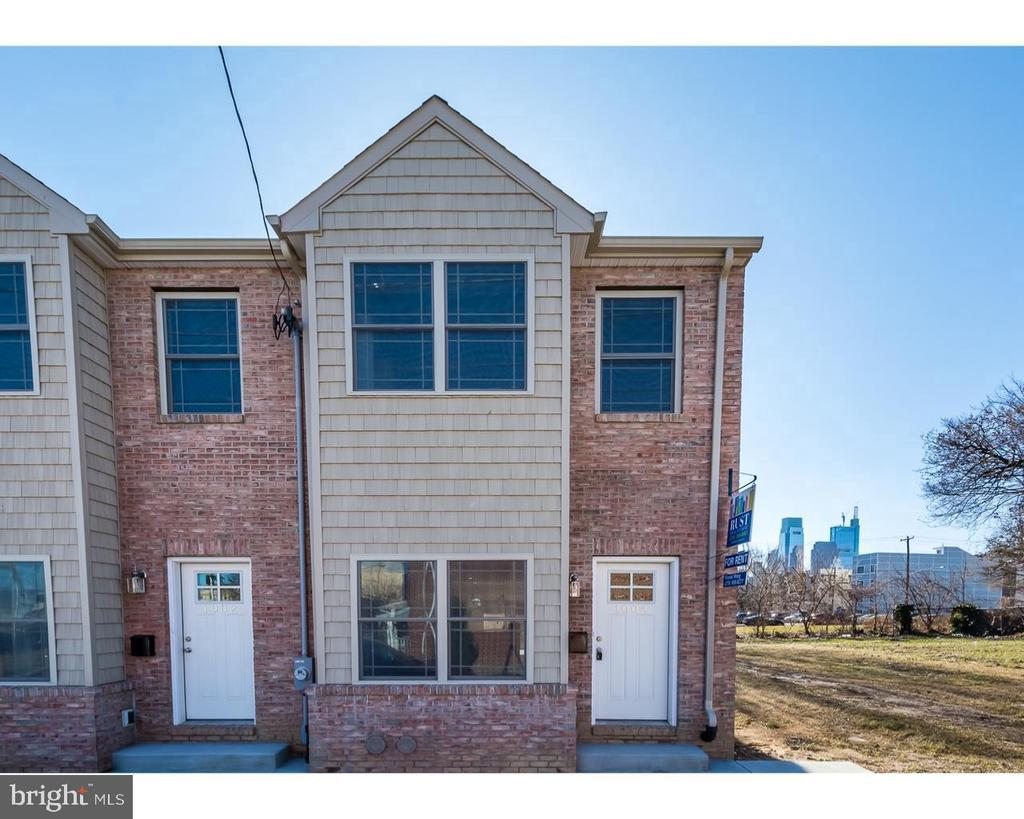 Two year new  twin house with hard wood floor through out, newer kitchen, tiled floor,granite countertop, stainless steel appliances.  Roof top deck, back yard. Great investment.