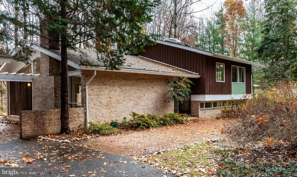 This is the one you have been waiting for - Carderock Springs Club View model designed by Lethbridge, Condon and Keyes and built by Edward Bennett in 1965.   Listed on the National Register of Historic Places.  Rarely do these come up for sale and this home is nearly as it was in 1965.  Large treed lot backing to woods.  Separate garage.  Community pool and tennis, many active community clubs.  A once in a lifetime opportunity to own a true mid-century treasure.  Act NOW.