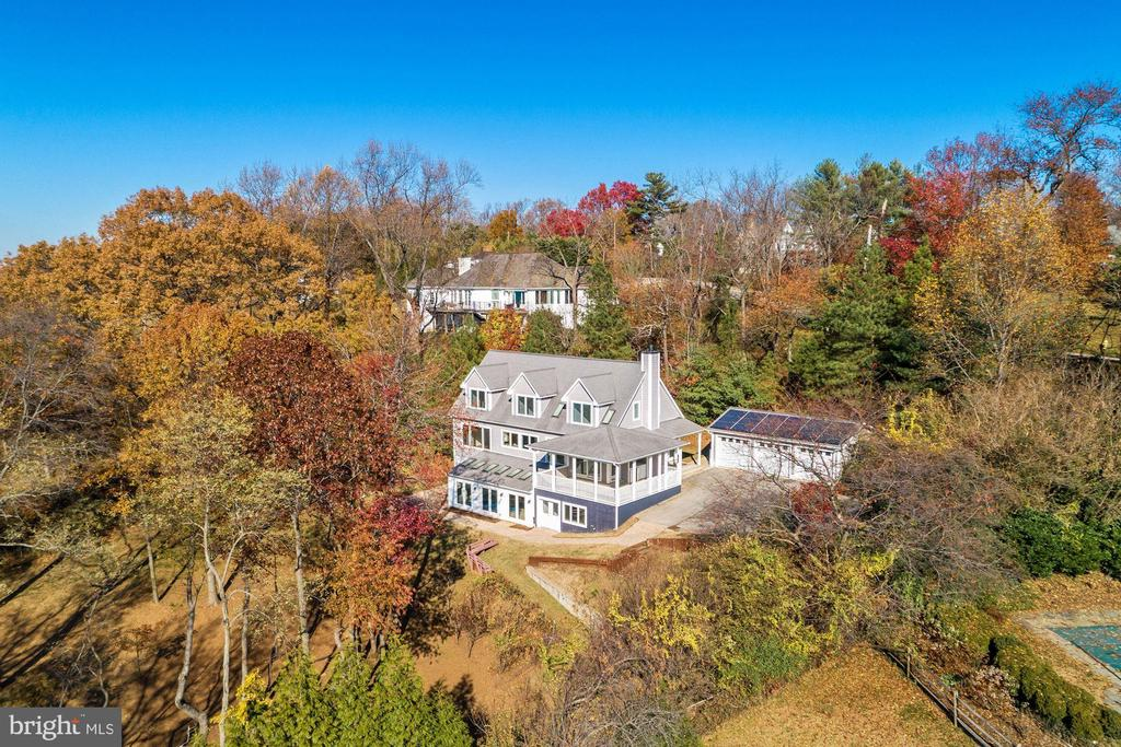 "Tucked away from the hustle and bustle, a lovely shingle style house sits quietly nestled on a prime 1.1-acre waterfront lot offering stunning, panoramic views of the Magothy River, serene wooded grounds, and wonderful privacy.  Relax and enjoy your family and friends while watching bald eagles and osprey soaring, diving and fishing, and countless resplendent sunsets over the Magothy from the oversized open porch complete with a wet bar. Built in 2001 and owned by the original owner, this extremely solid, carefully thought out, five-bedroom, three and a half bath three-level home is filled with natural light, magnificent water views throughout, high ceilings, clerestory windows above the stairway and skylights galore.  On the main level is a welcoming great room with a large Maryland sandstone fireplace opening into a kitchen with cherry wood cabinetry, a large open porch off the great room, and a first-floor master bedroom with en suite bath and laundry room, and a high-tech study.  Ascend the second level to three oversized bedrooms, all with fantastic waterfront views, two with walk-in closets, and a bathroom suite with a large jetted soaking tub.With lovely views of the Magothy throughout, the lower level has a media/recreational room with built in cabinetry and a wet bar, a pool room with an Endless Pool with radiant heat ceiling tiles, and a good-sized workshop. This level also has a waterfront guest suite with its own private entrance, a sitting room, full bath and washer/dryer.  Additionally, there is a large walk-in cedar closet and FEMA emergency hurricane shelter room.A virtually invisible solar array provides electricity to the house and power is stored in a Tesla Powerwall which provides power automatically during utility power outages.  Just wait until you see the electric bills!  Also included is a whole house water filtration system.  This house could be modified to accommodate an elevator and an additional fireplace could be installed where built-in cabinetry currently is located. With plentiful room for parking, a large detached three car garage, and more than 4,800 square feet of living space, this well-built waterfront home awaits its new owner for many years of unparalleled enjoyment.   Please be on notice that the MLS designates this property to have a screened porch, but it does not have screens--there was nowhere to designate a porch, so ""screened porch"" was selected--this porch could easily be converted to a screened porch, but it does not currently have screens. In fact, it used to be a screened porch.   Information on Gibson Island--A private island within one hour of Washington, D.C., and Baltimore; absolutely extraordinary setting - 1000 acres with seven miles of shoreline, two thirds of land undeveloped and owned by the Gibson Island Corporation, one third residential home sites, no need to cross the Bay Bridge - located on Western Shore of Maryland, 43-acre spring fed fresh water lake, enormous privacy and security--entry gatehouse staffed 24+Hours and Gibson Island Police Force (GIPD),Gibson Island Corporation Service Department for homeowners offering yard maintenance and landscaping and other services, full service yacht yard, 20 minute drive to BWI, airport and train station, private country club (membership by invitation) offering yachting, fine dining year-round, tennis, award-winning Charles Blair Macdonald designed 9-hole golf course, swimming, croquet, skeet shooting, and more, private tours by appointment. (C) Gibson Island Corporation, all rights reserved."