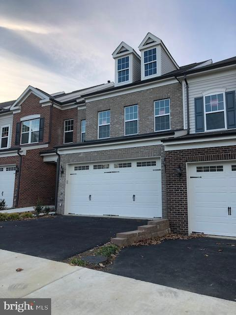 BRAND NEW MILLER AND SMITH HOME READY NOW IN WALHAVEN. Only 3 homes remain. Walhaven is a 55+ enclave of 32 elevator townhomes in Alexandria. It is part of the Kingstowne master community, and has all the Kingstowne amenities. 2,850 square feet, with brick front and an open floor plan, this home has hardwood floors throughout the main level with the great room open to a chef~s kitchen with white painted cabinets with soft close, white quartz counters and stainless steel appliances, including a chimney hood. Upstairs is a master suite with a tray ceiling and an enormous walk in closet. Two more bedrooms, a hall bath and a large laundry room complete the upper level. The lower level has a generous recreation room, full bath and a large storage area. Your private elevator makes for easy access to all 3 levels. Shown by appointment only. Price/terms/availability subject to change. Photos are of the model home.