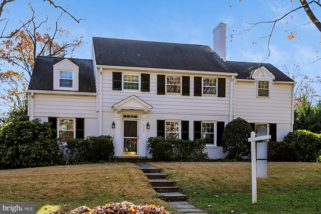 This is a rare opportunity in Sumner for a 0.25-acre level lot with an expanded colonial-style home featuring four bedrooms and three full baths on the upper level.  The master bedroom has a walk-in dressing area with skylight and a walk-in closet.  The spacious master bath features a double basin vanity and ceramic tiled shower.  The expanded and renovated kitchen features custom wood cabinets, granite countertops, and stainless steel appliances as well as an eat-in breakfast area with sliding door access to the rear deck.  The main level features a large formal living room with fireplace, entertaining sized dining room, den or office (could be a main floor bedroom) with powder room, and a rear family room addition with access to the driveway, garage and rear deck.  The home also has a rear-loaded one car garage and a fantastic large and level, completely fenced, rear yard. with endless possibilities for expansion or a pool or whatever you desire.  All windows have been updated and the hardwood floors have recently been refinished hardwood.