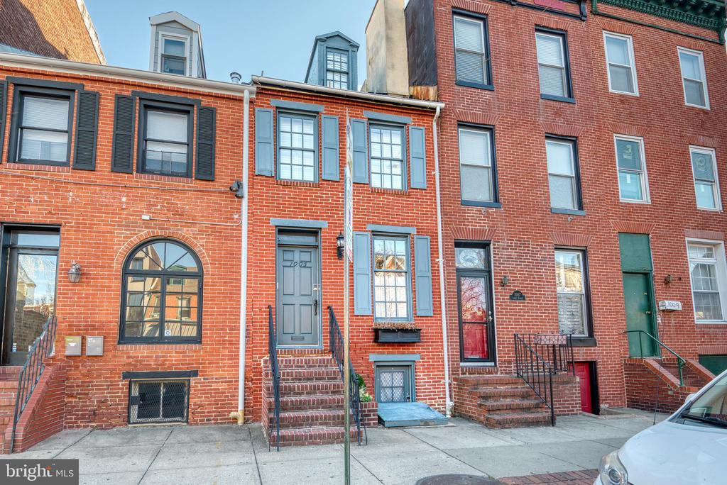 Immerse yourself in historic charm in this 3 Bed 2 bath home in the center of popular Federal Hill! Original hardwood floors, brick accent walls, 1800s fireplace mantles, built ins, formal dining room, and large eat in kitchen with built in desk space. Second level with 2 spacious bedrooms that flank fully renovated center hall bathroom and lead to a  lovely deck . Entire 3rd level is owns suite with large bedroom, office or reading nook, updated bath and amble closet space.  Finished basement with in unit Laundry and private PARKING  in rear of house! So close to everything, snuggled amongst local restaurants, bars, shops and a around the corner from Federal Hill Park and the Inner Harbor. Easy commute to University of Maryland, Johns Hopkins, the Baltimore Business District and commuter routes I95, I295 & I83. Pets considered and home available fully furnished for extra fee!
